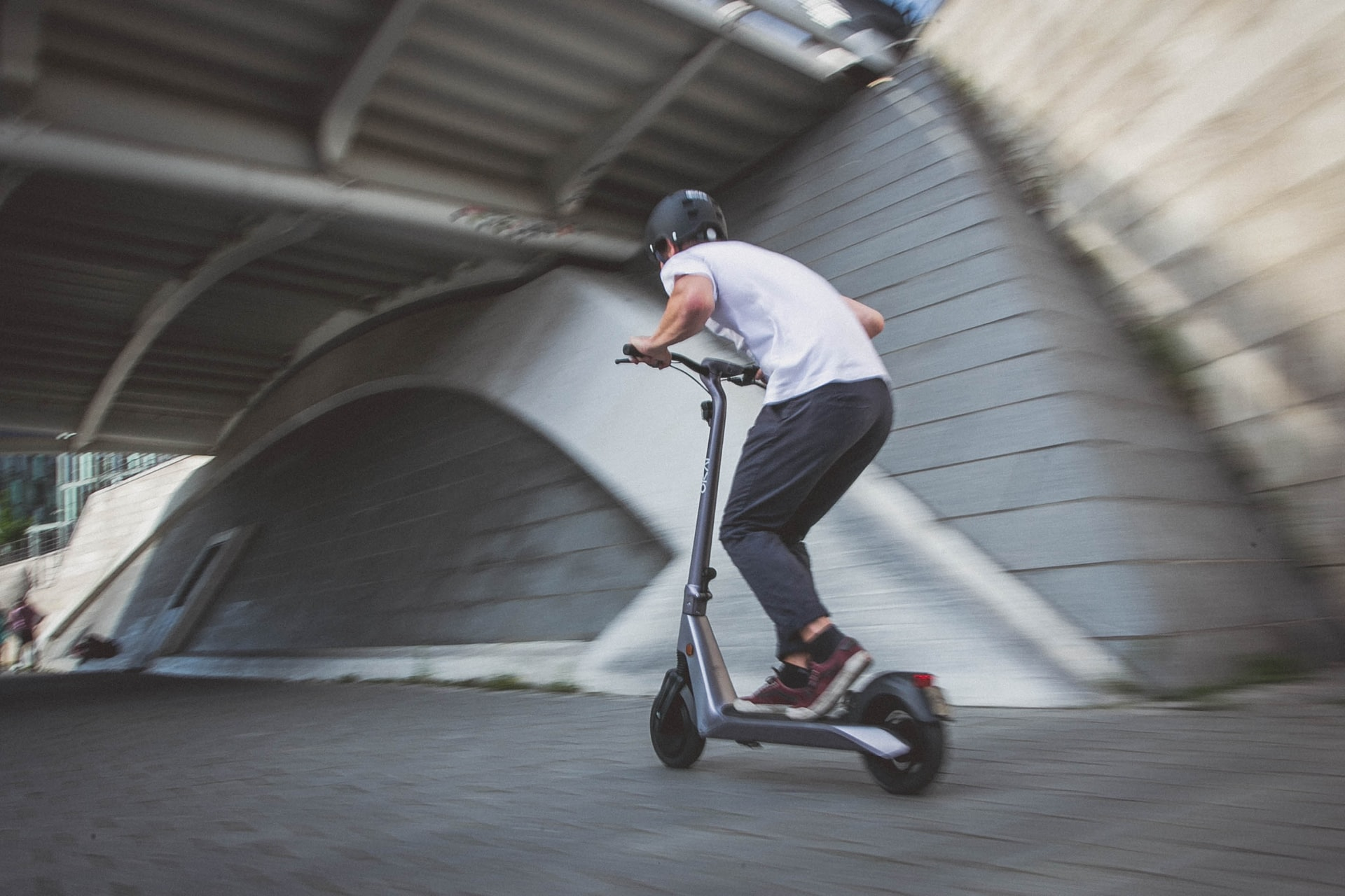 electric scooter being ridden